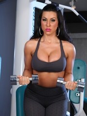 Brianna Jordan models her sweet body as she works out in the gym. She starts off