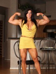 Angela Salvagno flexs her biceps triceps abs quads and hamstrings before she starts