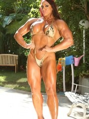 Big defined sexy and shiny describes Amber Delucas awesome muscles in this hot bikini