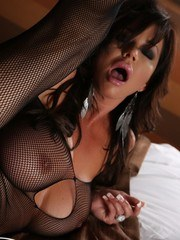 Rachel Aziani is dolled up in sexy lingerie and shows off her big tits and big clit.