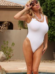 Rachel Aziani shows off her white retro swimsuit as she gets wet in the pool