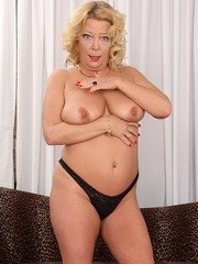 Mature slut gets naked and shows off her mature pussy and tits