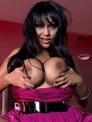 Hot and sexy Priya Anjali Rai climbs up on the counter and shows off her big boobs