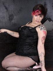 Dors Feline strips out of her black corset and fishnets