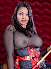 Busty asian Mika Tan get nude and spread her pussy wide.
