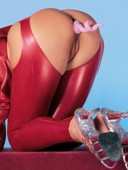 Hot redhead in red latex outfit loves dildos and real cock
