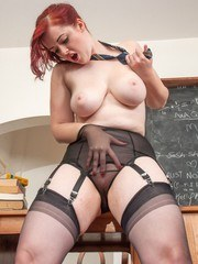 Curvy redhead Jay gets into bother with her big breasts being loose in her white