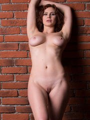 Aphrodita displays her luscious body with big tits and she poses on the chair.