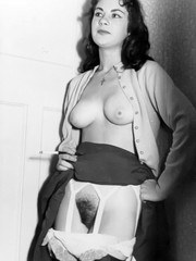 Horny 1960s stocking clad bushy pussy brunette!