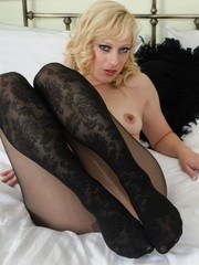 Axa is very keen to show off her sexy pends encased in fancy black pantyhose!