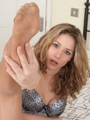 Sophie teases tearing the pantyhose from her feet!