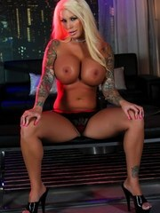 Big tit blondie Lolly gets topless in the night club