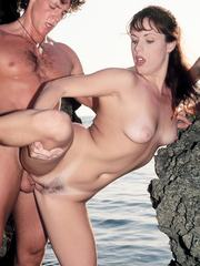 Redhead Hardcore session at the beach ends in cumshot facial