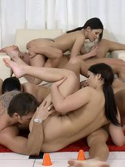 Young bike girls fucking two horny studs in groupsex game