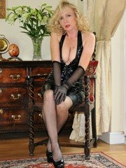 Blonde plays in pvc and nylons