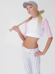 Francesca slips out of her uniform and tries to fit the end of her baseball bat somewhere