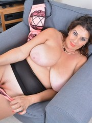 Big breasted housewife Lulu showing off her big assets