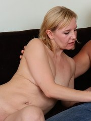 Naughty mature slut doing her lover on the couch