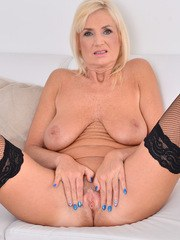 Czech cougar Roxana Hanova is 58 and still hot as hell. She slips out of her evening