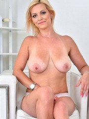 A simple dress accentuates every one of Kirsten Klarks stunning curves. Her bra and