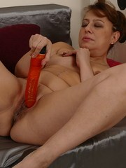 Naughty housewife fingering her wet pussy