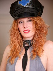 Officer Monita is ready to bring you to your knees! This blazing Czech redhead may