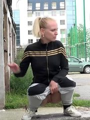 Gorgeous blonde babe pissing in public