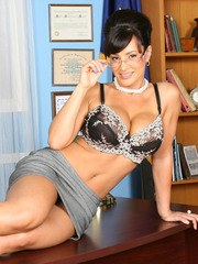 Lisa Ann as the outspoken and sexy Governor Palin as she poses on her desk