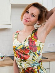 All natural housewife Alice Wonder loves to get it on anywhere including the kitchen.
