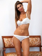 Russian mom Liya Lucky will light up your life with her huge enhanced tits and her