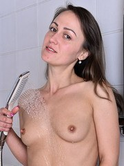 Sexy Angel Karyna gets dripping wet showering