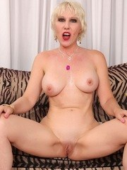 Sexy old woman takes off her clothes and shows off her mature tits and pussy