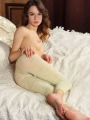 Debora A sensually strips on the bed as she bares her tight body.
