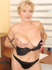 Horny gran Maya Lambert takes off her bra and plays with her boobs and privates