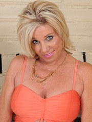 Hot blonde housewife Payton Hall undresses to show off those nice big breasts