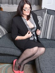 Naughty British mature lady playing on her couch