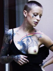 Sasha Beart flaunts her lusty tattooed body and creamy pussy by the stairs.