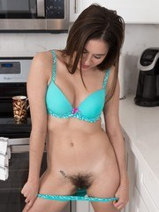 Shyla Jennings is in her kitchen wearing her green dress and green panties. She strips