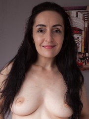 Di Devi is modeling her red lingerie and showing off her hairy pits and pussy too.