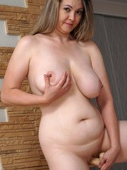 Bigtit milf Anastasiya is a buxom delight whose giant knockers are all natural. This