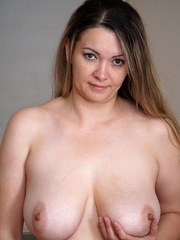Anastasiya is a thick mom with a curvy body and huge breasts. She cant keep her hands