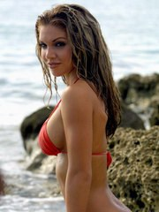 Woman in red swimsuit gets wet