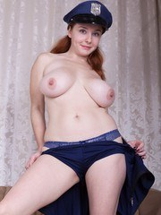 Elouisa is dressed as a sexy policewoman in blue. She poses on her couch then strips