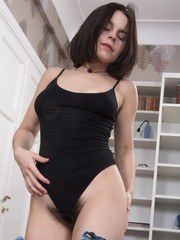 Ole Nina is in her bedroom showing off her sexy hairy body. She has hairy pits and