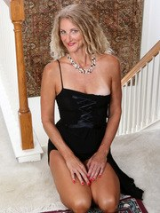An evening gown outlines Zoe Markss slim figure as the horny housewife flirts with