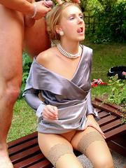 Three horny clothed cuties sharing two large dicks outdoors