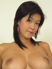 Busty Bangkok model Irene Fah can barely control her tits