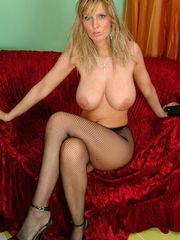 Busty Milly in pantyhose getting naked