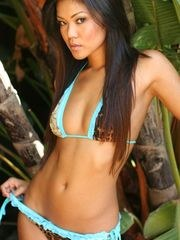 Tropical babe strips out of her tiny bikini