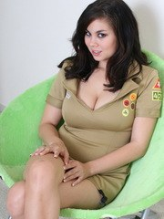 Busty babe Mai Ly strips out of her slutty girl scout uniform exposing her big juicy